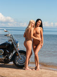 Two beautiful naked women with motorcycle Royalty Free Stock Photos