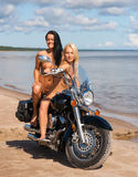 Two beautiful naked women with motorcycle Stock Photo