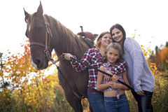 Three adult woman outdoors with horse child Royalty Free Stock Photo