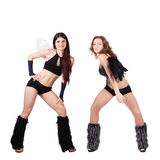 Two beautiful naughty go-go dancers Stock Photo