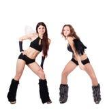Two beautiful naughty go-go dancers Stock Photo