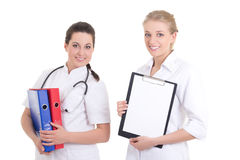 Two beautiful nurses with folders. copyspace Stock Images