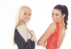 Two beautiful party girls on white isolated background Royalty Free Stock Image
