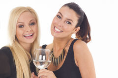 Two beautiful party girls on white isolated background Royalty Free Stock Photo