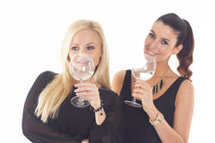 Two beautiful party girls on white isolated background Royalty Free Stock Images