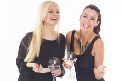 Two beautiful party girls on white isolated background Royalty Free Stock Photography