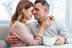 Two beautiful people man and woman hugging and taking pleasure,. Two beautiful people men and women hugging and taking pleasure while relaxing together in Royalty Free Stock Image