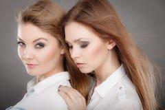 Two beautiful photomodels portrait. Royalty Free Stock Photo