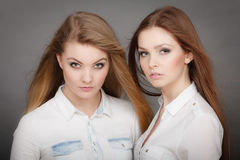 Two beautiful photomodels portrait. Royalty Free Stock Photo
