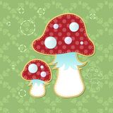 Two beautiful poisonous fly agarics on a green background. Illustration Royalty Free Stock Photo