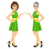 Two beautiful professional fair hostess women showing something. Over white background Stock Images