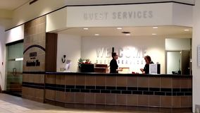 Two beautiful receptionist behind the service desk at guest service counter. stock footage