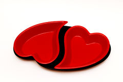 Two beautiful red hearts. On a white background Royalty Free Stock Photos