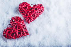 Two beautiful romantic vintage red hearts together on a white snow background. Love and St. Valentines Day concept. Stock Image