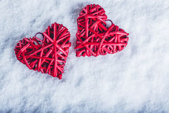 Two beautiful romantic vintage red hearts together on a white snow background. Love and St. Valentines Day concept. Stock Photography