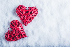 Two beautiful romantic vintage red hearts together on a white snow background. Love and St. Valentines Day concept. Two beautiful romantic vintage red hearts Stock Photography