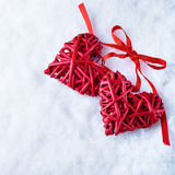 Two beautiful romantic vintage red hearts together on a white snow winter background. Love and St. Valentines Day concept Royalty Free Stock Photo