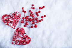 Two beautiful romantic vintage red hearts together on white snow winter background. Love and St. Valentines Day concept Stock Image
