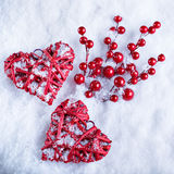 Two beautiful romantic vintage red hearts together on a white snow winter background. Love and St. Valentines Day concept Royalty Free Stock Photos