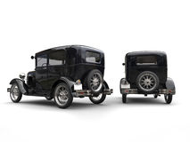 Two beautiful 1920s vintage cars - side by side - back view Stock Photos