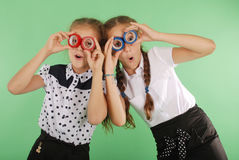 Two beautiful school girl holding two insulating tape on eyes Stock Photo