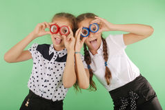 Two beautiful school girl holding two insulating tape on eyes Stock Photos