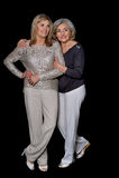 Two beautiful senior women. Posing against black background stock image