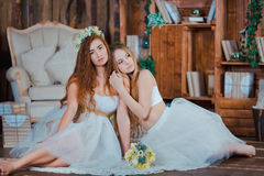 Two beautiful sensual brides sitting in vintage Stock Photos