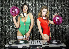 Two beautiful sexy disco dj women in bikinis performing in a clu Royalty Free Stock Photos