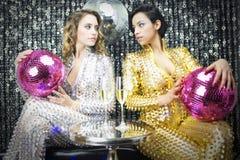 Two beautiful disco women royalty free stock image