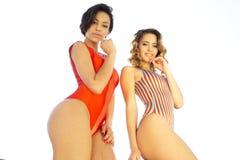 Two beautiful sexy women in bikinis Stock Images