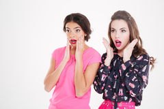 Two beautiful shocked young women standing with opened mouths Royalty Free Stock Images