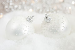 Two beautiful silver baubles Royalty Free Stock Images