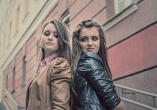 Two beautiful sisters of the girlfriend stand on street Royalty Free Stock Image