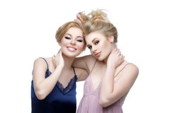 Two beautiful sisters holding each other hair Royalty Free Stock Photography
