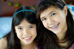 Two beautiful sisters in home environment Stock Image