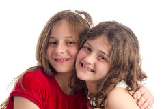 Two Beautiful Sisters hugging isolated Royalty Free Stock Images