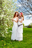 Two beautiful sisters outdoors Royalty Free Stock Images