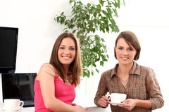 Two beautiful sisters relax at home. Two young and  beautiful sisters relax at home Stock Photo