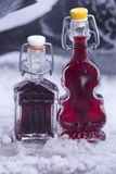 `Liqueur from cherries and choke berry in beautiful small bottles.` stock image
