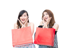 Two beautiful smiling asian young women with shopping sale bags Royalty Free Stock Photos