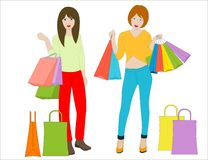 Two beautiful smiling girls and shopping bags Stock Photos