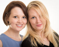 Two Beautiful Smiling Sisters Against A White Background Stock Photography
