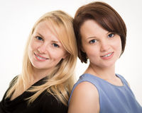 Two Beautiful Smiling Sisters Against A White Background Royalty Free Stock Photo