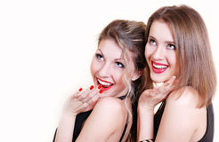 Two beautiful smiling surprised girls Stock Photo