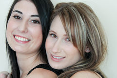 Two beautiful smiling women. Close up of two beautiful smiling women Royalty Free Stock Photography