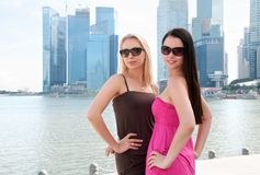 Two beautiful smiling women in Singapore Stock Images