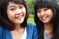 Two beautiful smiling young girls Stock Photos