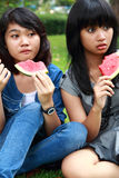 two beautiful smiling young girls eating watermelon Stock Photos