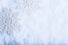 Two beautiful sparkling vintage snowflakes on a white frost snow background. Winter and Christmas concept Stock Photos
